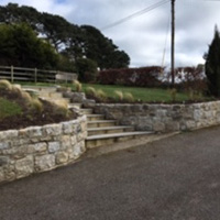 Granite steps with retaining curved wall either side