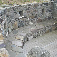 Curved stone seating area and retaining wall